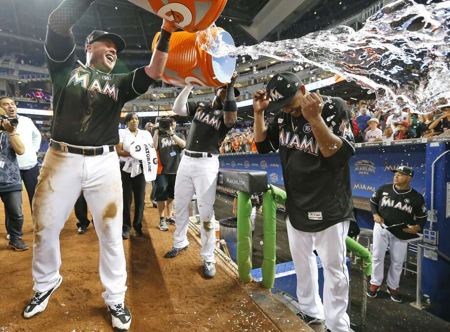Miami Marlins' Justin Bour, left, and Marcell Ozuna, center rear, pour ice and water onto starting pitcher Edinson Volquez, right, after the Marlins defeated the Arizona Diamondbacks 3-0 in a no-hitter by Volquez during a baseball game, Saturday, June 3, 2017, in Miami. (AP Photo/Wilfredo Lee) Photo: Wilfredo Lee/Associated Press