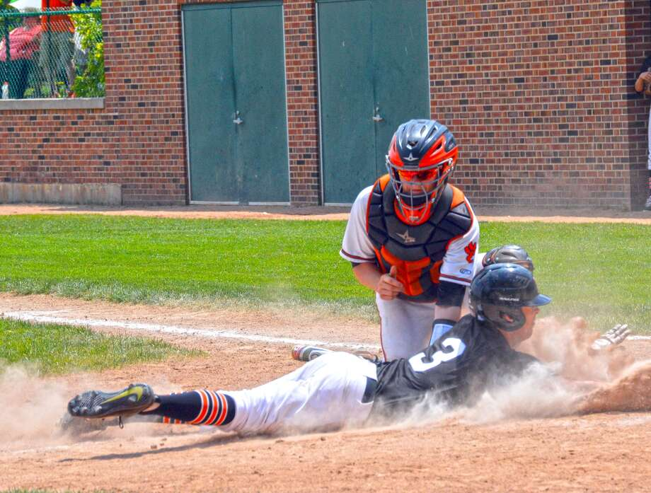 Edwardsville catcher Dalton Wallace tags out Andrew Kurdys at home plate for the second out of the second inning in Saturday's sectional championship at Illinois Wesleyan University in Bloomington.
