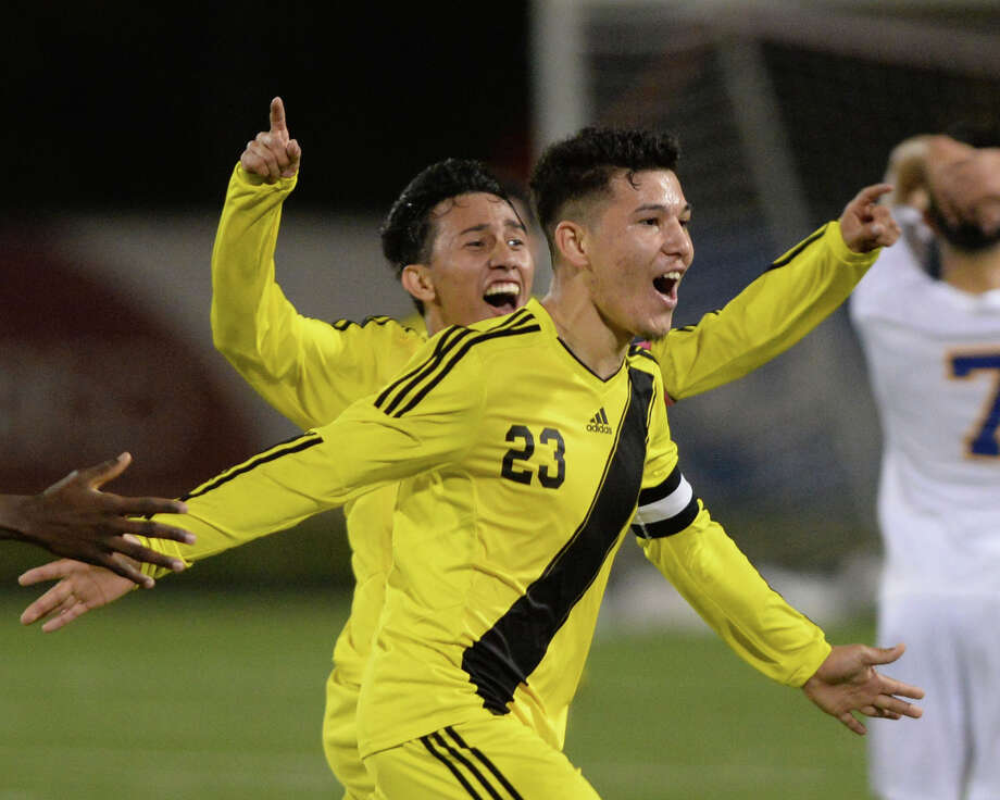 Manuel Flores (22) and Jose Guzman (23) of Wisdom celebrate a goal at the end of the second half of a boys bi-district soccer playoff game between the Elkins Knights and the Wisdom Panthers on Friday, March 24, 2017 at Hall Stadium, Missouri City, TX. Photo: Craig Moseley, Staff / ©2017 Houston Chronicle