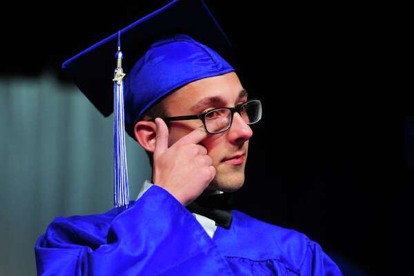 Christian heritage Academy graduate Micah Bristol wipes away a tear as he listens to a recorded letter to him by one of his teachers during the academy's 34th annual Commencement Exercises in Trumbull, Conn., on Saturday June 3, 2017.