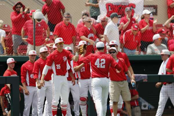 Houston Cougars pitcher John King (42) is congratulated by teammates after the third inning during the 2017 NCAA Houston Regional baseball game between the Houston Cougars and the Baylor Bears at Schroeder Park on Saturday, June 3, 2017, in Houston, TX.