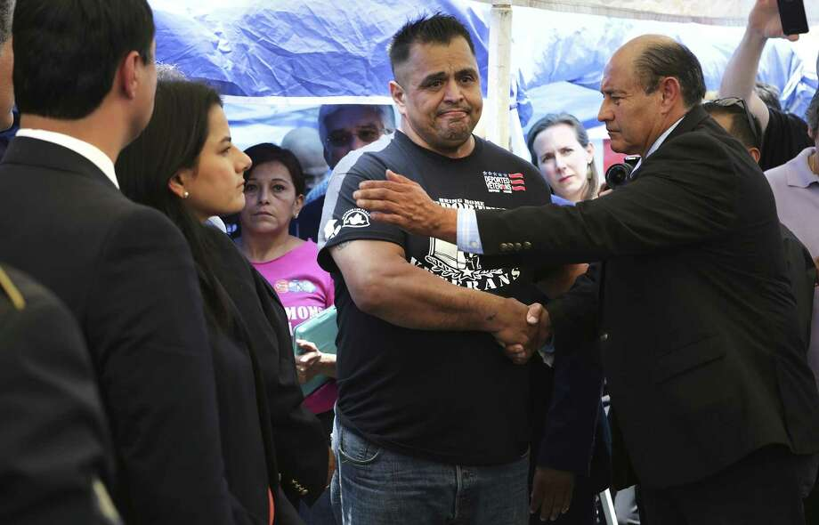 Congressman Lou Correa of California, right, comforts Enrique Salas, a deported veteran, as members of U.S. Congress visit with deported veterans at The Deported Veterans Support House in Tijuana, Mexico, on Saturday, June 3, 2017. Photo: Bob Owen, Staff / San Antonio Express-News / ©2017 San Antonio Express-News