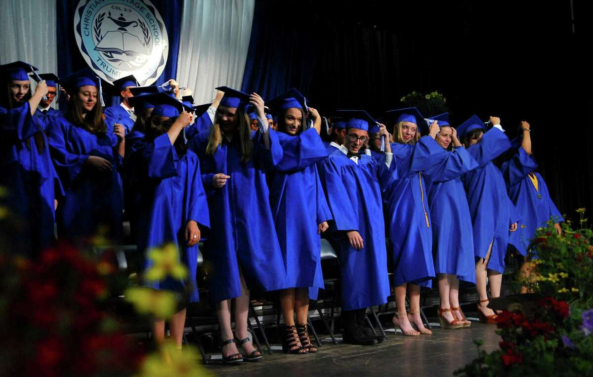 Christian Heritage Academy graduates turn their tassels from right to left according to tradition during the academy's 34th annual Commencement Exercises in Trumbull, Conn., on Saturday June 3, 2017.