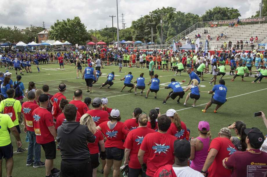 Teams compete in tug-of-war during the San Antonio Sports Corporate Cup at the University of the Incarnate Word in San Antonio, Texas on June 3, 2017. Ray Whitehouse / for the San Antonio Express-News Photo: Ray Whitehouse, Photographer / For The San Antonio Express-News
