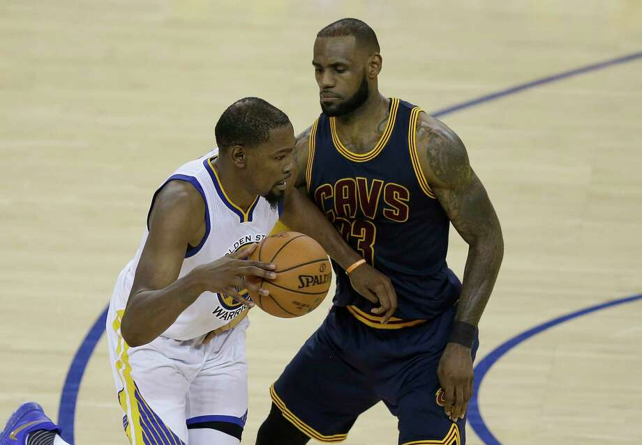 Golden State Warriors forward Kevin Durant, left, drives on Cleveland Cavaliers forward LeBron James during the second half of Game 1 of basketball's NBA Finals in Oakland, Calif., Thursday, June 1, 2017. (AP Photo/Ben Margot) Photo: Ben Margot, STF / Copyright 2017 The Associated Press. All rights reserved.