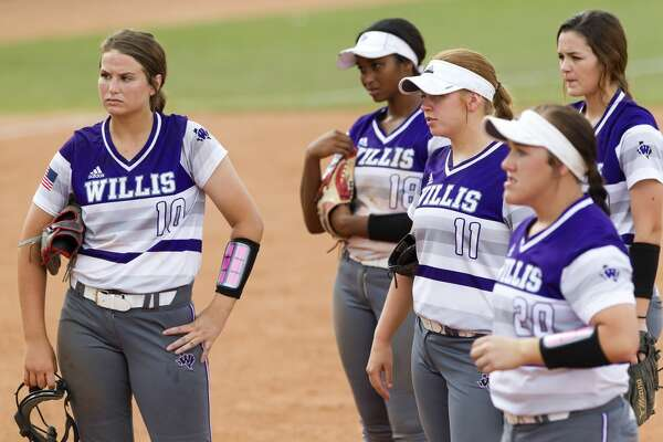 Willis players watch as head coach Stephanie Shelly disagrees with first base umpire Ralph Stromme after Jayda Coleman #24 of The Colony is ruled safe at second following a diving tag by first baseman Suzy Lopez in the fifth inning of the Class 5A final game during the UIL State Softball Championships at Red and Charline McCombs Field, Saturday, June 3, 2017, in Austin. The rule stood and Coleman remained on first base.
