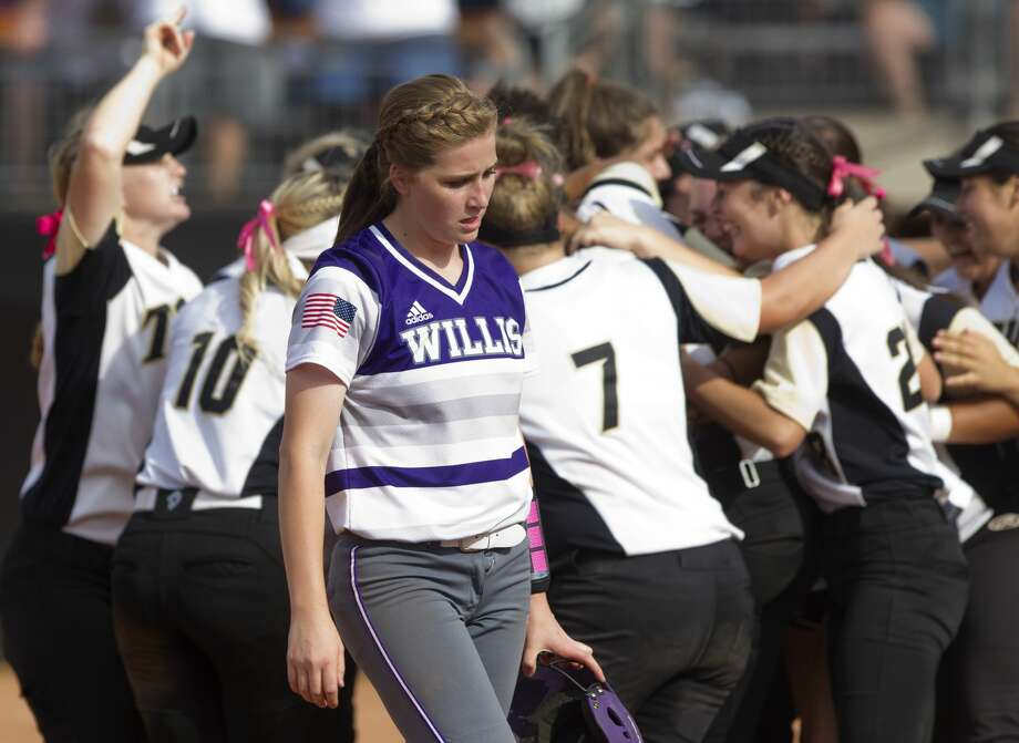 Willis' Lizzie Zwall walks past players from The Colony as they celebrate their 5-2 victory over the Wildkats in the Class 5A UIL state championship game at Red and Charline McCombs Field, Saturday, June 3, 2017, in Austin. Photo: Jason Fochtman/Houston Chronicle