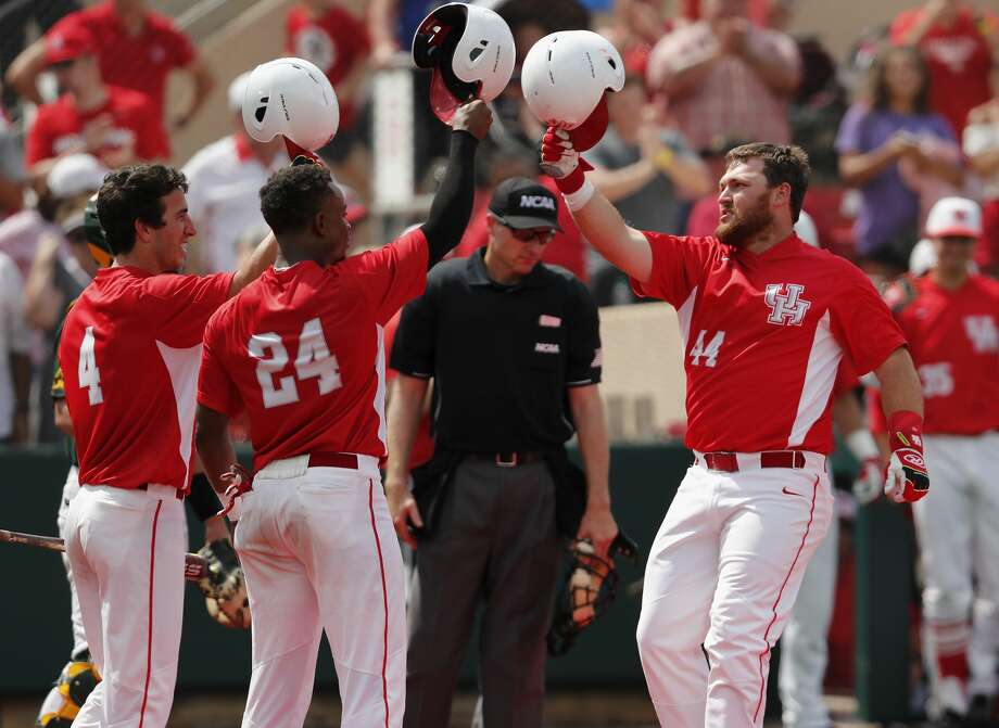 Houston Cougars first baseman Joe Davis (44) is greeted at home plate by infielder Cooper Coldiron (4) and infielder Corey Julks (24) after a sixth inning home run during the 2017 NCAA Houston Regional baseball game between the Houston Cougars and the Baylor Bears at Schroeder Park on Saturday, June 3, 2017, in Houston, TX. Photo: Tim Warner/For The Chronicle