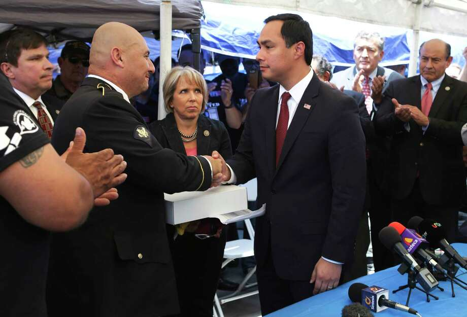 Congressman Joaquin Castro, center right, presents an American flag that flew over the U.S. Capitol to Hector Barajas, a deported U.S. Army veteran at The Deported Veterans Support House in Tijuana, Mexico.  Photo: Bob Owen, Staff / ©2017 San Antonio Express-News