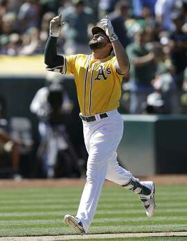 Oakland Athletics' Yonder Alonso celebrates after hitting a two run home run off Washington Nationals' Jacob Turner during the seventh inning of a baseball game Saturday, June 3, 2017, in Oakland, Calif. (AP Photo/Ben Margot)