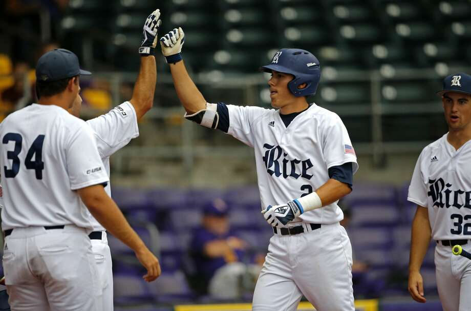 Rice's Tristan Gray (2) is greeted at the dugout after his solo homer in the second inning of an NCAA college baseball tournament regional game against Texas Southern in Baton Rouge, La., Saturday, June 3, 2017. (AP Photo/Gerald Herbert) Photo: Gerald Herbert/Associated Press