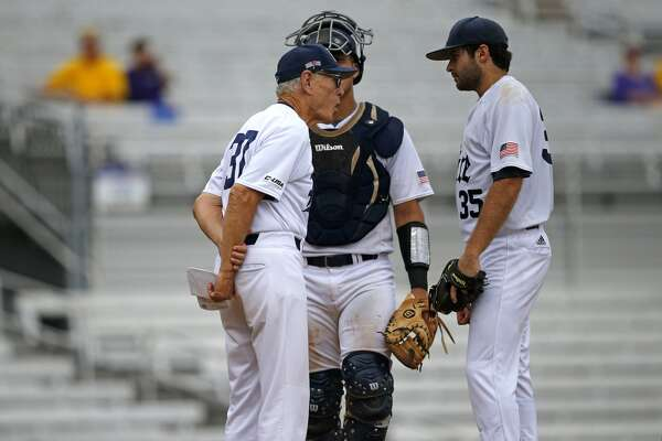 Rice head coach Wayne Graham, left, talks to pitcher Zach Esquivel (35) and catcher Dominic DiCaprio in the second inning of an NCAA college baseball tournament regional game against Texas Southern in Baton Rouge, La., Saturday, June 3, 2017. (AP Photo/Gerald Herbert)