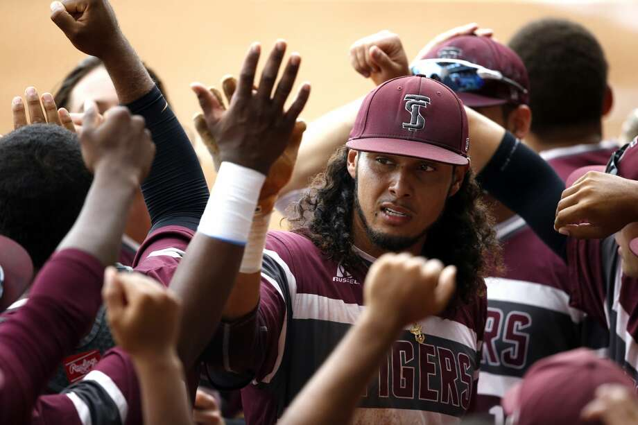 Texas Southern's Jose Camacho is greeted in the dugout after scoring on a two-run RBI-single in the first inning of an NCAA college baseball tournament regional game against Rice in Baton Rouge, La., Saturday, June 3, 2017. (AP Photo/Gerald Herbert) Photo: Gerald Herbert/Associated Press