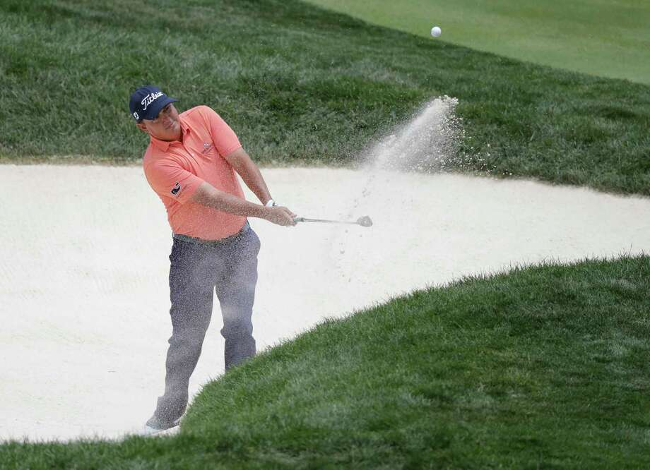 Jason Dufner hits out of a bunker on the fourth hole during the third round of the Memorial golf tournament, Saturday in Dublin, Ohio. Photo: Darron Cummings, STF / Copyright 2017 The Associated Press. All rights reserved.