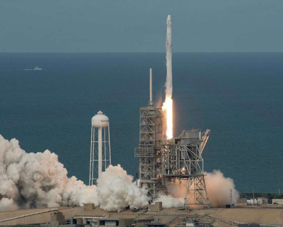 In this photo provided by NASA, the SpaceX Falcon 9 rocket, with the Dragon spacecraft onboard, launches from pad 39A at NASA's Kennedy Space Center in Cape Canaveral, Fla, Saturday, June 3, 2017.  SpaceX launched its first recycled cargo ship to the International Space Station on Saturday, yet another milestone in its bid to drive down flight costs. (Bill Ingalls/NASA via AP) Photo: Bill Ingalls, HOGP / (NASA/Bill Ingalls) For copyright and restrictions refer to -http://www.nasa.gov/multimedia/guidelines/index.html