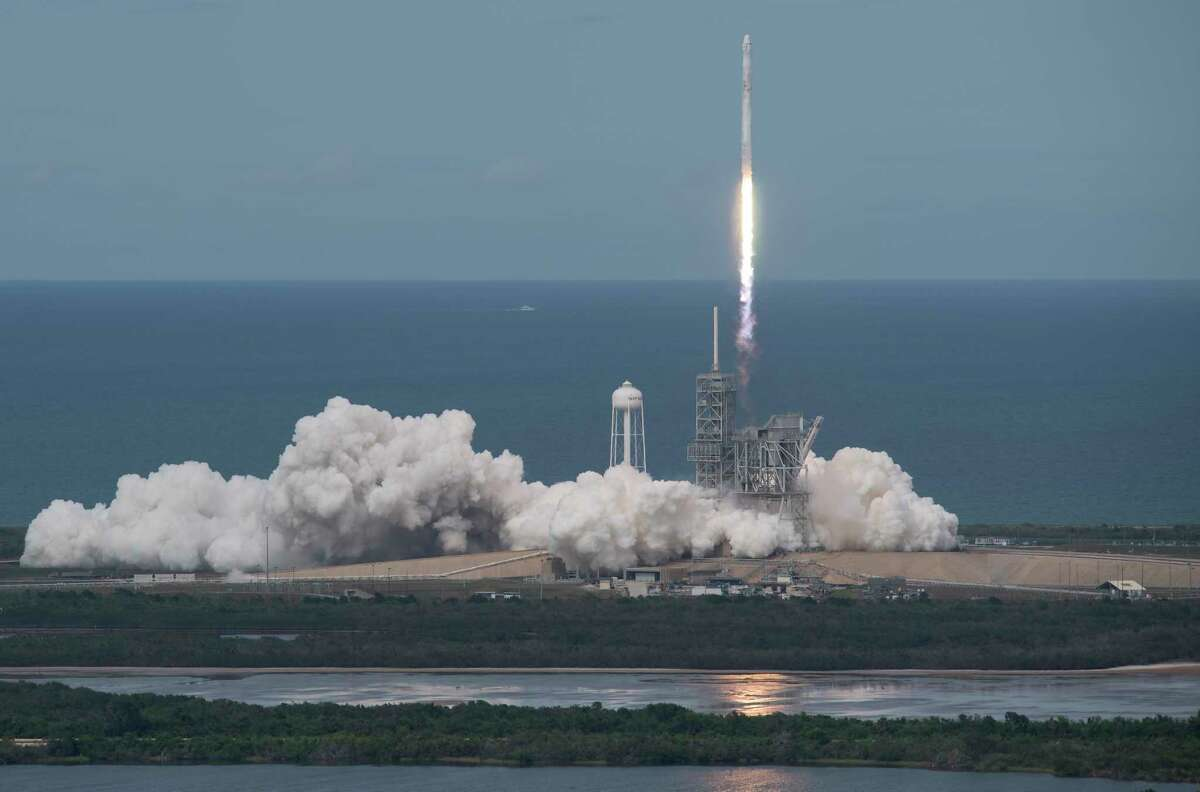 In this photo provided by NASA, the SpaceX Falcon 9 rocket, with the Dragon spacecraft onboard, launches from pad 39A at NASA's Kennedy Space Center in Cape Canaveral, Fla, Saturday, June 3, 2017. (Bill Ingalls/NASA via AP)