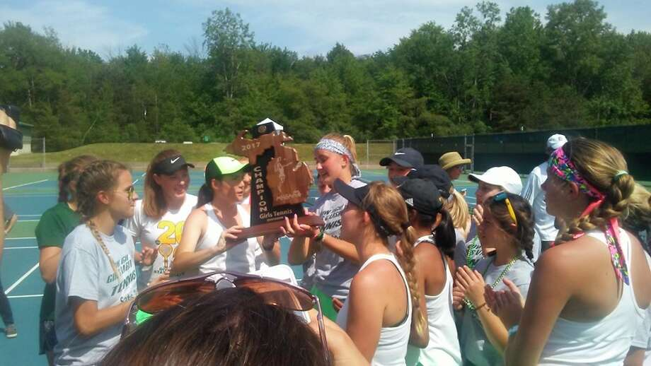DAN CHALK| chalk@mdn.net Members of the Dow High tennis team celebrate with the MHSAA trophy after earning a Division 1 co-championship along with Northville.