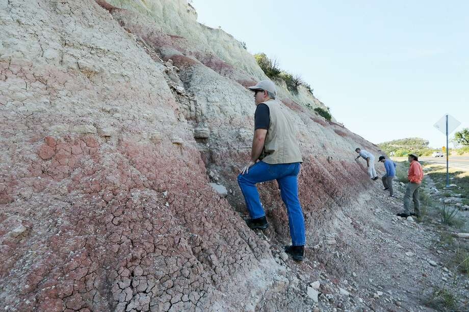 Thomas Adams (left), curator of Paleontology and Geology at the Witte Museum, and a team led by UTSA professor Marina Suarez, makes an initial assessment of deposits from the Hensel formation, laid during the Early Cretaceous period, from roadcuts along IH-10 just outside of Junction, TX, on Wednesday, May 24, 2017.  MARVIN PFEIFFER/ mpfeiffer@express-news.net Photo: Marvin Pfeiffer, Staff / San Antonio Express-News / Express-News 2017