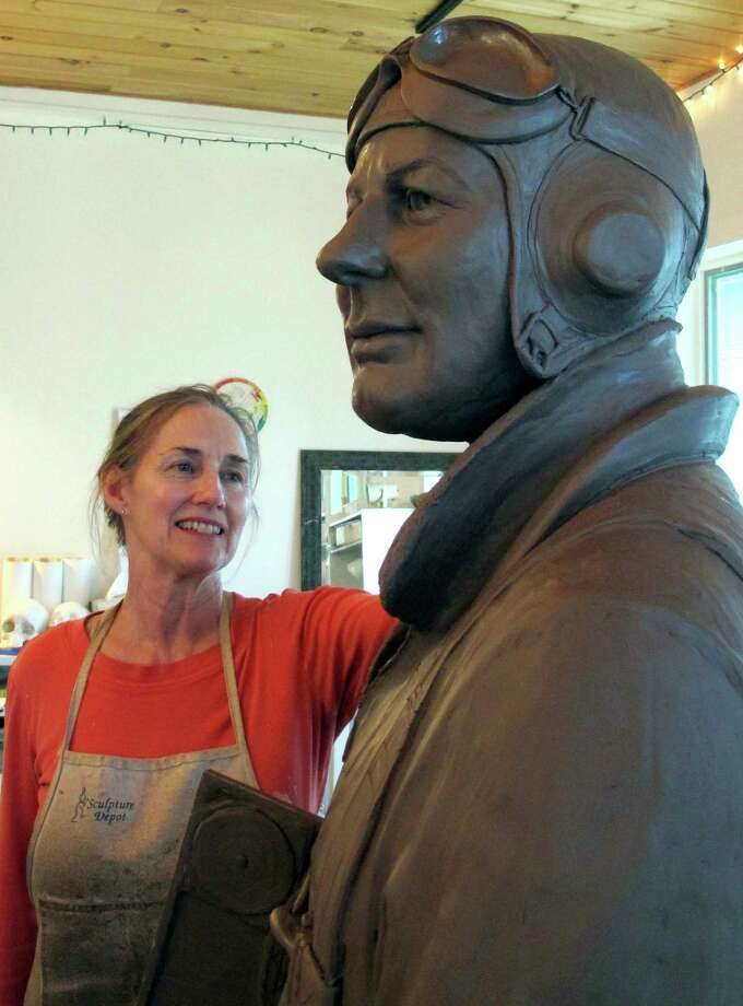 In this May 30, 2017 photo, sculptor Susan Geissler works on a clay likeness of World War II hero C. Wade McClusky Jr. in her Youngstown, N.Y., studio. The clay model will form the basis for a bronze monument planned for the Buffalo and Erie County Naval & Military Park in McClusky's hometown of Buffalo, N.Y. A dedication ceremony is scheduled for June 4, the 75th anniversary of the Battle of Midway and of McClusky's heroics as a pilot. (AP Photo/Carolyn Thompson) Photo: Carolyn Thompson, STF / Copyright 2017 The Associated Press. All rights reserved.
