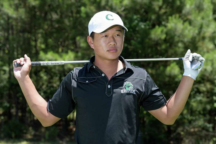 Golfer, Ben Wong, a Junior at John Cooper High School in the Woodlands, Texas is the All-Greater Houston Boys Golfer of the Year and poses for a photo at The Club at Carlton Woods in The Woodlands on Tuesday, May 23, 2017. Photo: Wilf Thorne / © 2017 Houston Chronicle