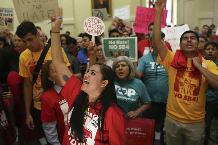 Paola Rodriguez joins protesters against SB4 at the State Capitol, Monday, May 29, 2017. The bill, known as Sanctuary City, was signed by Governor Greg Abbott and will take effect on Sept. 1, 2017. It gives local law enforcement department the power to question a person's citizenship. Photo: JERRY LARA / San Antonio Express-News / © 2017 San Antonio Express-News