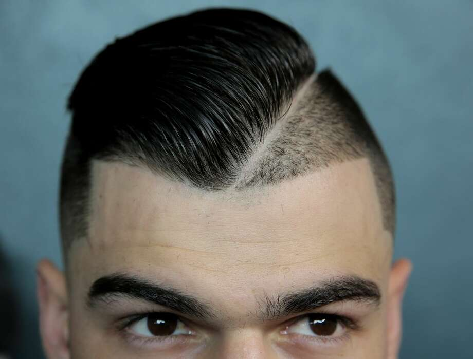 Houston Astros starting pitcher Lance McCullers Jr. (43) and his hair style.