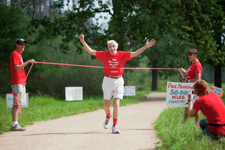 Paul Merriman, 85 at the time, breaks through the tape commemorating his 50,000th mile during a 2012 celebration with family at Memorial Park. Photo: TODD SPOTH, Photographer / © TODD SPOTH, 2012