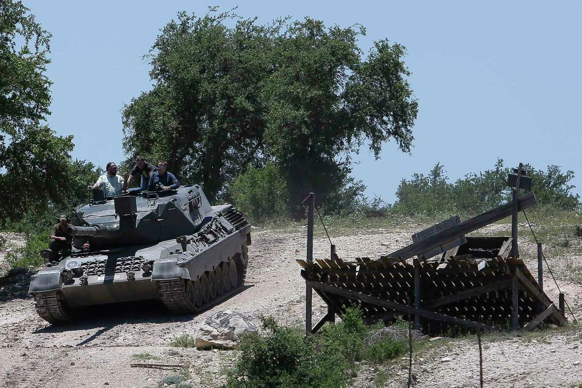 DriveTanks.com customers drive the German Leopard 1A4 Tank through the tank course at Ox Ranch Wednesday, May 24, 2017 in Uvalde. At the ranch, people can drive and shoot the main canon of vintage WWII-era tanks and fire a variety of machine guns, artillery and other heavy guns. ( Michael Ciaglo / Houston Chronicle )