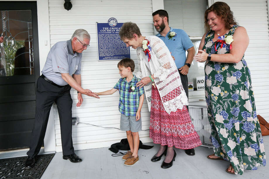 Mayor Toby Powell, far left, high fives Maxwell Walker, 6, who is with his grandmother Carolyn Walker, center, and parents Andrew and Khristene Walker during the Montgomery County Historical Marker Plaque Dedication of the Grogan-Cochran House on Saturday, June 3, 2017, at the Heritage Museum in Conroe. Photo: Michael Minasi, Staff Photographer / © 2017 Houston Chronicle