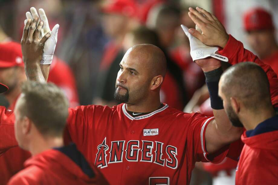 ANAHEIM, CALIFORNIA - JUNE 03:  Albert Pujols #5 of the Los Angeles Angels of Anaheim celebrates with teammates in the dugout after hitting career home run number 600, a grand slam in the fourth inning against the Minnesota Twins at Angel Stadium of Anaheim on June 3, 2017 in Anaheim, California.  (Photo by Stephen Dunn/Getty Images) Photo: Stephen Dunn/Getty Images
