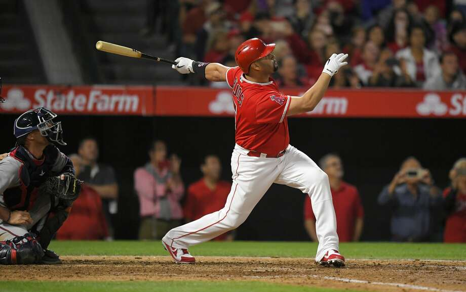 Los Angeles Angels' Albert Pujols, right, follows through on a solo home run, the 600th homer of his career, as Minnesota Twins catcher Chris Gimenez watches during the fourth inning of a baseball game, Saturday, June 3, 2017, in Anaheim, Calif. (AP Photo/Mark J. Terrill) Photo: Mark J. Terrill/Associated Press