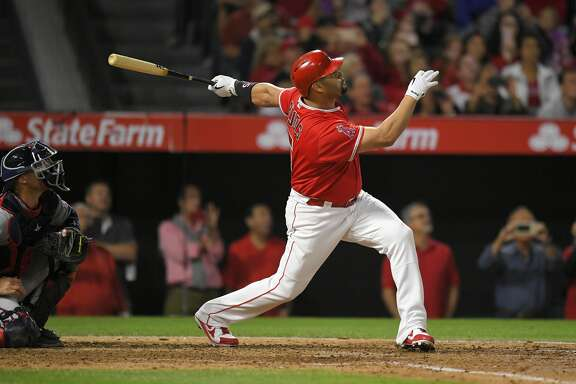 Los Angeles Angels' Albert Pujols, right, follows through on a solo home run, the 600th homer of his career, as Minnesota Twins catcher Chris Gimenez watches during the fourth inning of a baseball game, Saturday, June 3, 2017, in Anaheim, Calif. (AP Photo/Mark J. Terrill)