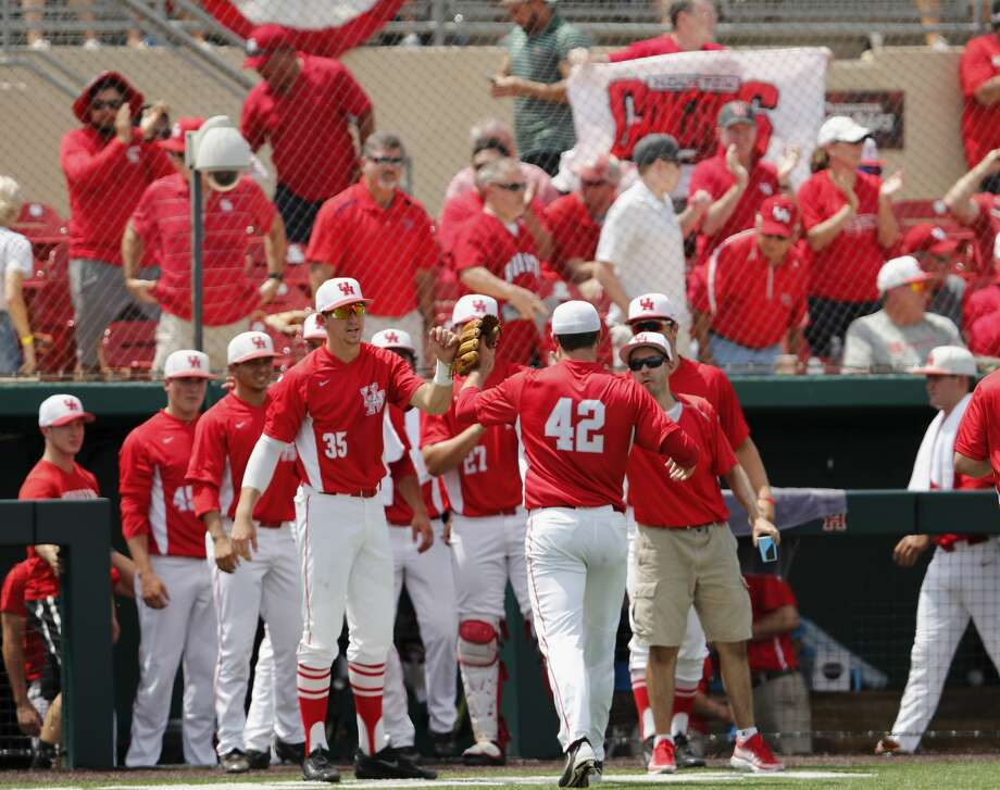 Houston pitcher John King (42) is congratulated by teammates after the third inning against Baylor during an NCAA college baseball tournament regional game Saturday, June 3, 2017, in Houston. (Tim Warner/Houston Chronicle via AP)/Houston Chronicle via AP) Photo: Tim Warner/Associated Press