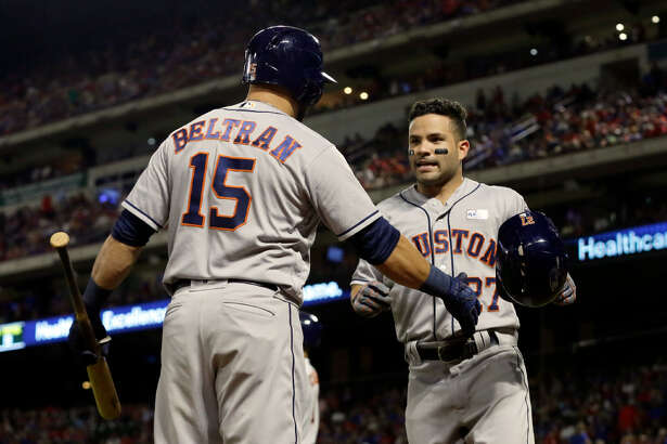 Houston Astros' Carlos Beltran (15) and Jose Altuve, right, celebrate a solo home run by Altuve in the ninth inning of baseball game against the Texas Rangers, Saturday, June 3, 2017, in Arlington, Texas. (AP Photo/Tony Gutierrez)