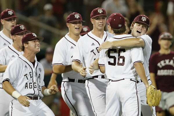 Texas A&M players celebrate with pitcher Taylor Chafin (56) after coming in to save the game in the ninth inning during the 2017 NCAA Houston Regional baseball game between the Iowa Hawkeyes and the Texas A&M Aggies at Schroeder Park on Saturday, June 3, 2017, in Houston, TX.