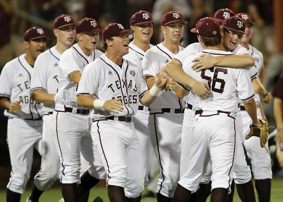 Texas A&M players celebrate with pitcher Taylor Chafin (56) after coming in to save the game in the ninth inning during the 2017 NCAA Houston Regional baseball game between the Iowa Hawkeyes and the Texas A&M Aggies at Schroeder Park on Saturday, June 3, 2017, in Houston, TX. Photo: Tim Warner/For The Chronicle