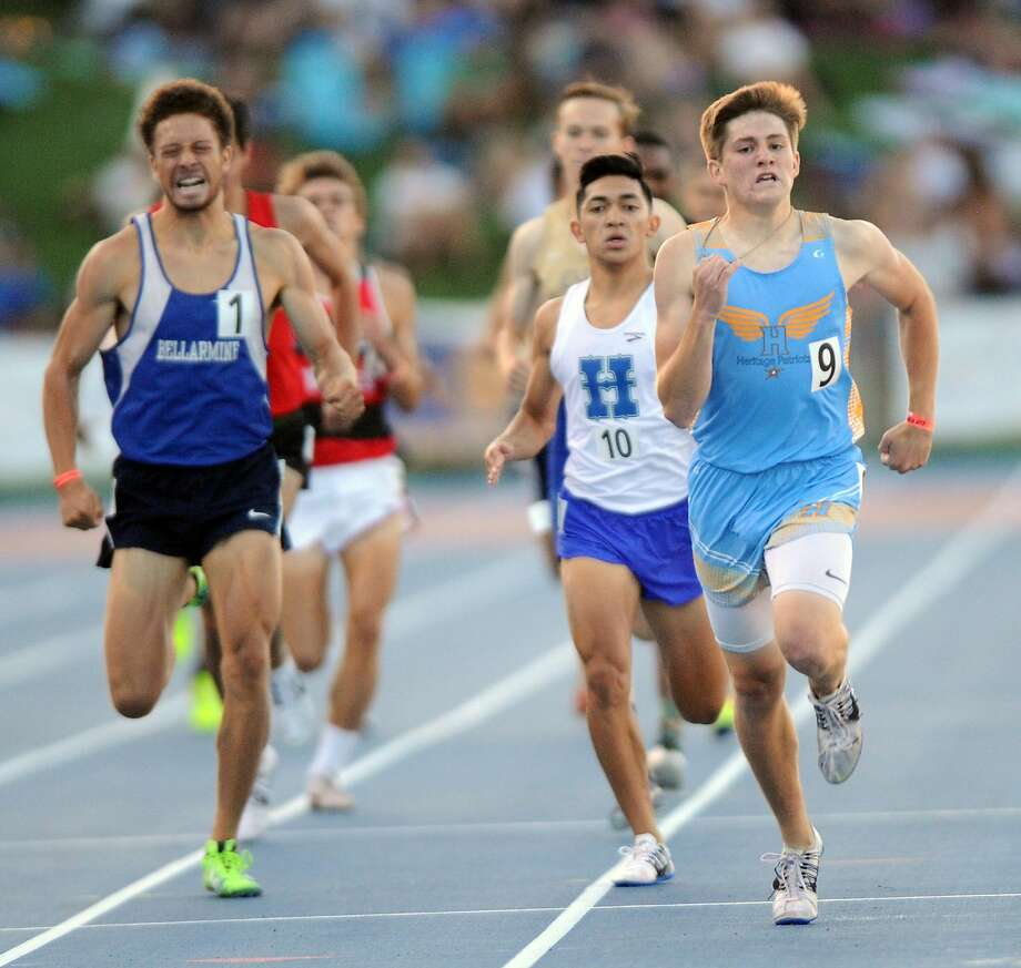 Heritage-Brentwood junior Jett Charvet broke away from a tight field including Bellarmine junior Alex Scales to win the state title in the 800 in 1:51.07. Photo: Eric Taylor/1string.com