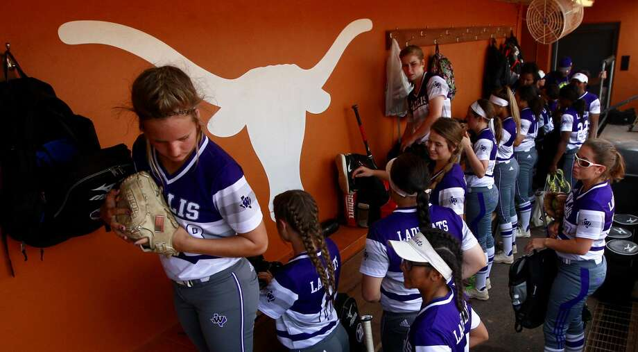 Willis players unload their gear before the Class 5A final game during the UIL State Softball Championships at Red and Charline McCombs Field, Saturday, June 3, 2017, in Austin. Photo: Jason Fochtman/Houston Chronicle