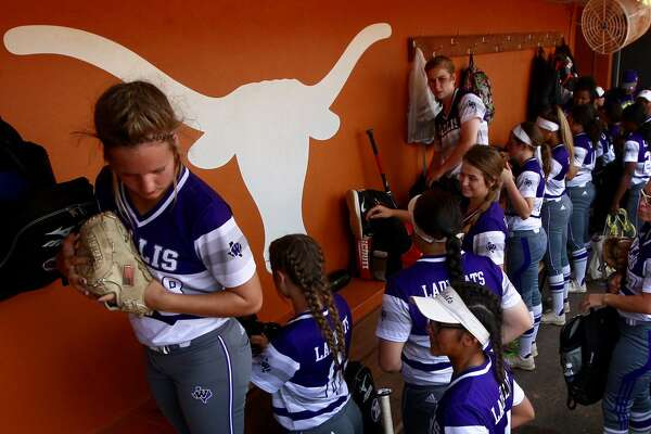 Willis players unload their gear before the Class 5A final game during the UIL State Softball Championships at Red and Charline McCombs Field, Saturday, June 3, 2017, in Austin.