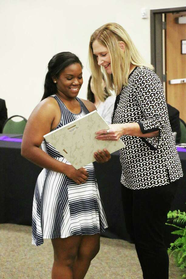 Jayla Pruitt accepts the award as the Dayton High School Female Athlete of the Year. Photo: David Taylor
