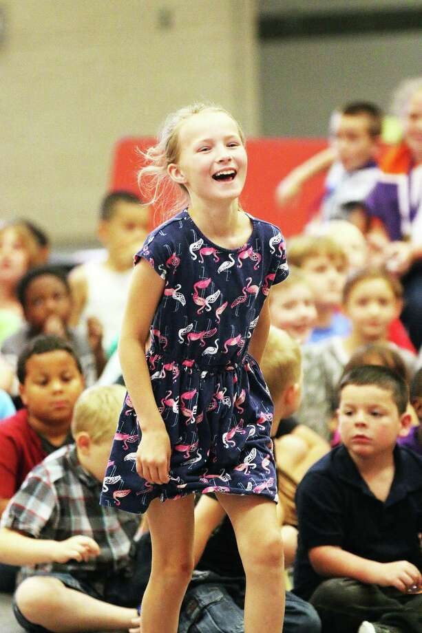 The priceless look on the face of second-grader Kimberlyn Hazlip-Nugent as she was announced the winner in her class for the Discipline Award was priceless. She was headed to join her other award winners in the Gallery of Champions on stage. Photo: David Taylor