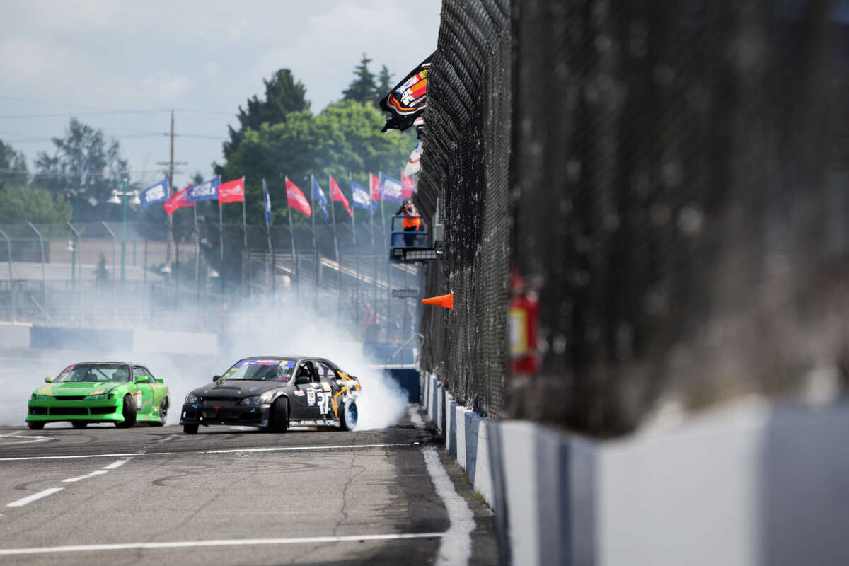 Racers move in tandem as they come close to an outside wall during DriftCon at Evergreen Speedway in Monroe on Saturday, June 3, 2017.