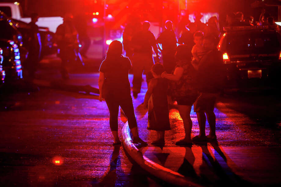 Residents, both displaced and neighbors, gather to comfort one another in the streets of Autumnwood Apartments as firefighters continue to battle a fire, believed to have been sparked by lightning, that destroyed multiple apartments units on Saturday, June 3, 2017, in Conroe. Photo: Michael Minasi, Staff Photographer / © 2017 Houston Chronicle