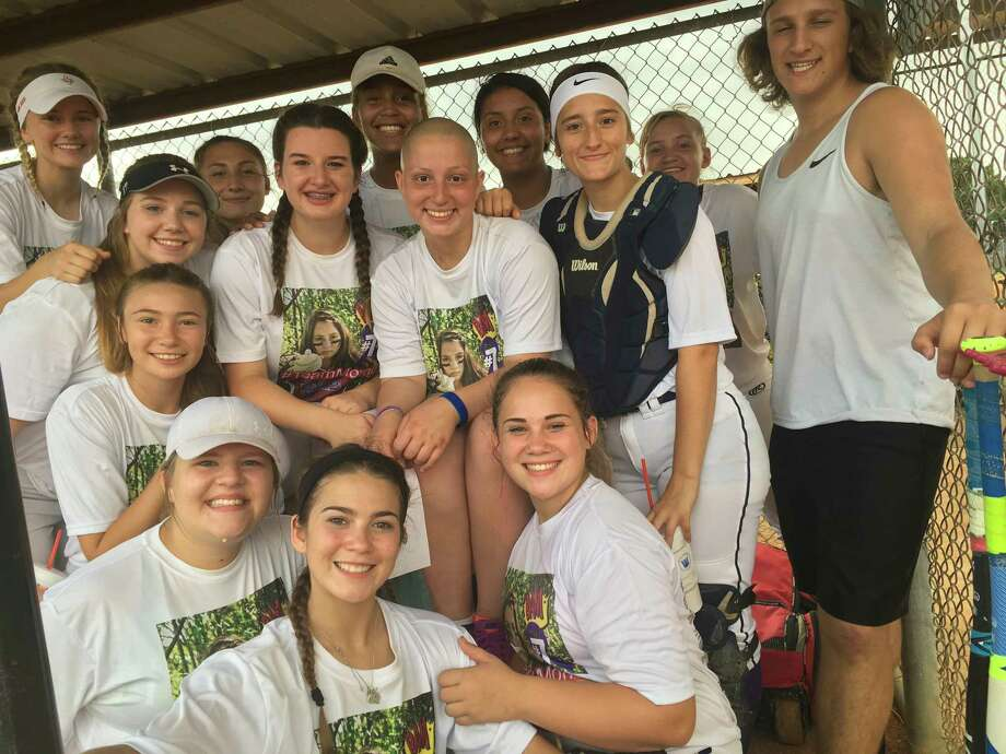 "Morgan ""Momo"" Carnish and the rest of the U18 Texas Cobras are all smiles in the dugout as they wait out a rain delay before their game at the Humble Girls Softball League benefit tournament on June 2 at Lindsay Lyons Park Photo: Elliott Lapin"