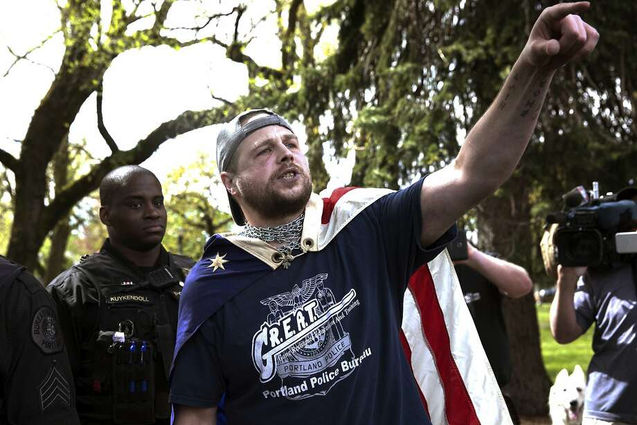 Jeremy Joseph Christian speaks during a Patriot Prayer gathering on April 29 in Portland, Ore. He is charged with fatally stabbing two men who tried to stop his anti-Muslim tirade. Photo: John Rudoff, Associated Press