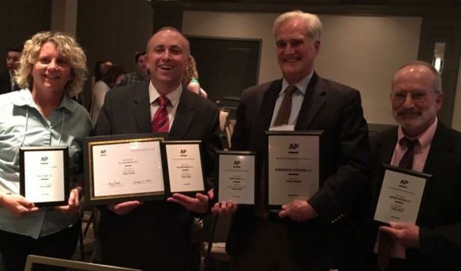 """The New York State Association Press Association named the Times Union a """"Newspaper of Distinction"""" in its circulation category June 3, 2017. Individual first place award winners from the newspaper included from left to right: photographer Lori Van Buren; editorial design director Tom Palmer, Editor Rex Smith shown with newspaper of distinction award, and editorial page editor Jay Jochnowitz."""