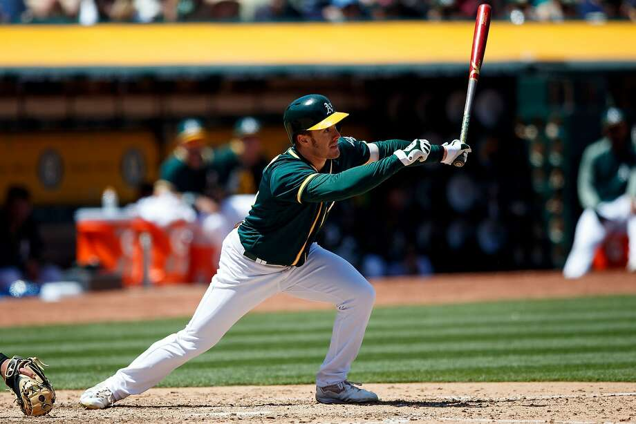 OAKLAND, CA - MAY 10:  Mark Canha #20 of the Oakland Athletics hits a single against the Los Angeles Angels of Anaheim during the fifth inning at the Oakland Coliseum on May 10, 2017 in Oakland, California. The Oakland Athletics defeated the Los Angeles Angels of Anaheim 3-1. (Photo by Jason O. Watson/Getty Images) Photo: Jason O. Watson, Getty Images