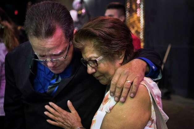 Juan Rodriguez shares a moment with his mother-in-law Zoila Vargas at his daughter's graduation, Saturday, June 3, 2017, in Houston. Rodriguez has to present himself to the Immigration and Customs Enforcement at the end of the month of June and possibly be deported to El Salvador. Photo: Marie D. De Jesus, Houston Chronicle / © 2017 Houston Chronicle
