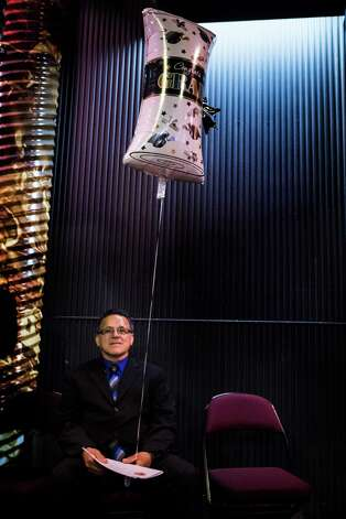 Juan Rodriguez sits with a graduation congratulatory balloon for his daughter Karen Rodriguez who is graduating from high school. The Immigration and Customs Enforcement told him he has to leave the country at the end of this month but was allowed to go to his daughter's high school graduation. Photo: Marie D. De Jesus, Houston Chronicle / © 2017 Houston Chronicle