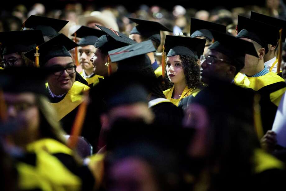 Karen Rodriguez, 18, sits among other Cristo Rey Jesuit graduates during their commencement ceremony at the Revention Music Center, Saturday, June 3, 2017, in Houston. Photo: Marie D. De Jesus, Houston Chronicle / © 2017 Houston Chronicle